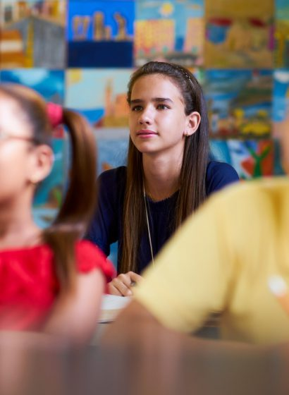 smart-girl-listening-to-teacher-at-school-PQV6SHN-Copier.jpg